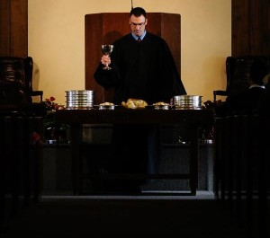 Newly-ordained Rev. Mark Vander Pol administers the Lord's Supper