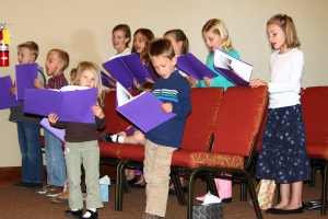 Children singing at New Covenant United Reformed Church in Twin Falls, Idaho